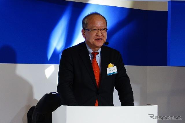 ブースでスピーチを行う日本グッドイヤーの金原雄次郎社長。《撮影 石田真一》