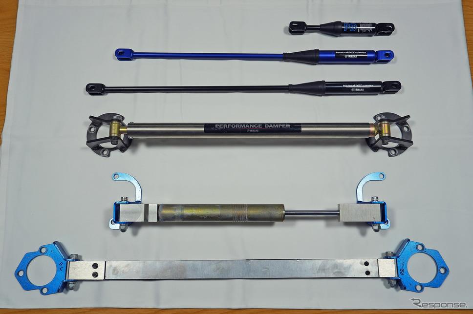 ヤマハのパフォーマンスダンパー。下の3つがクルマ用、上の3つがバイク用。《撮影 宮崎壮人》